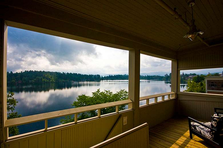 view of a lake from a wooden balcony