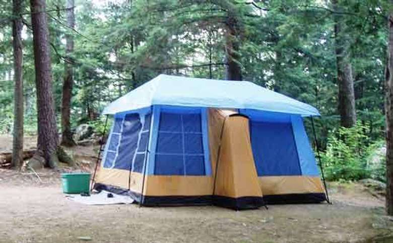 a blue and brown tent in the woods