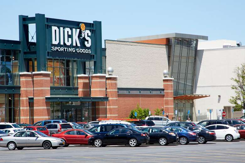 exterior of dick's sporting goods at crossgates mall with parking in front of it