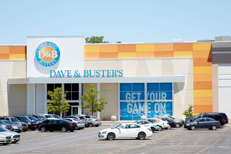 exterior of dave and buster's at crossgates mall with parking in front of it