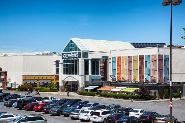 exterior of crossgates mall and the parking lot in front of it