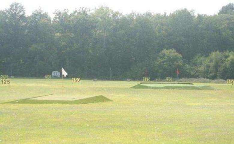 driving range with visible yardage markers and putting obstacles