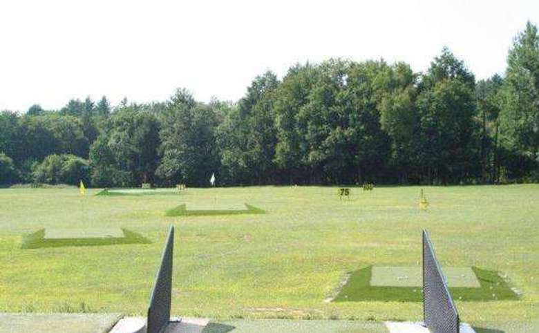 view out onto a driving range from one of the driving stations
