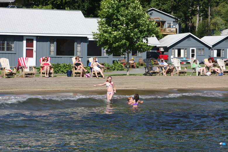 little girls swimming in the lake