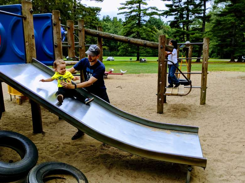 dad with kid on slide