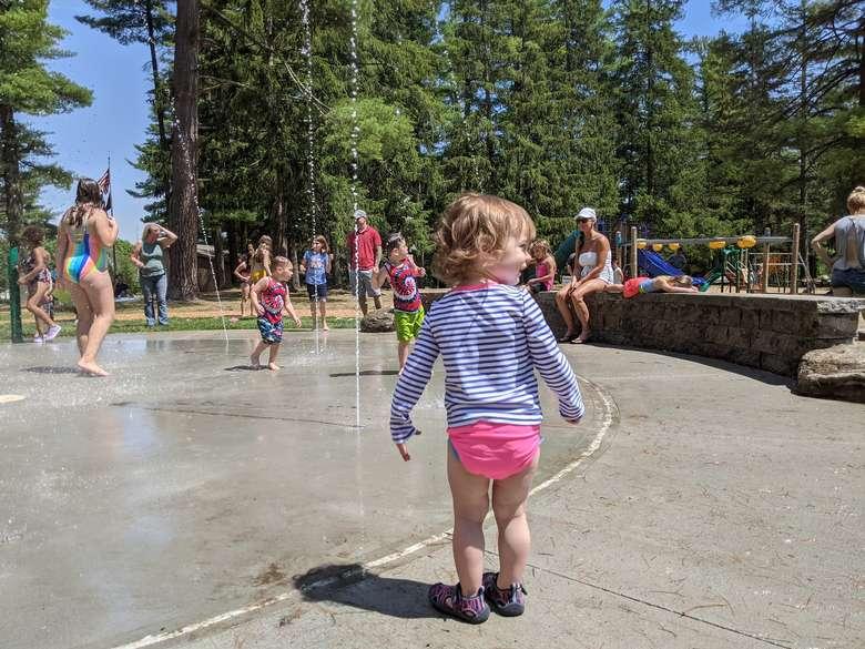 toddler at splash pad