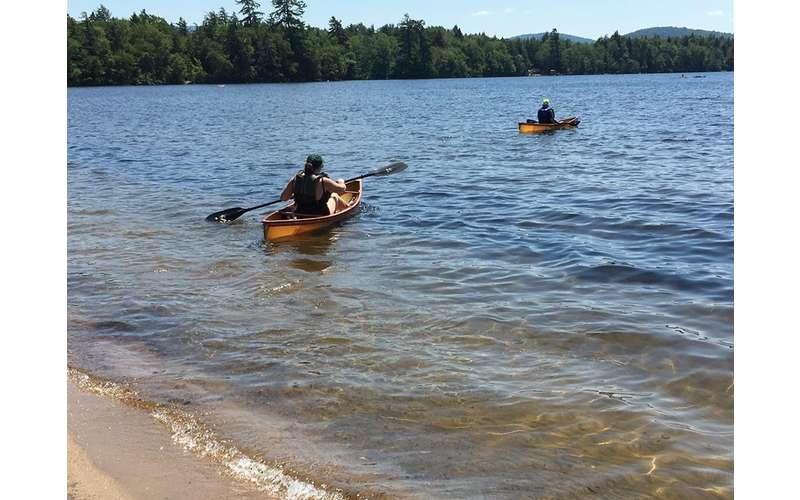 two paddlers on a waterway