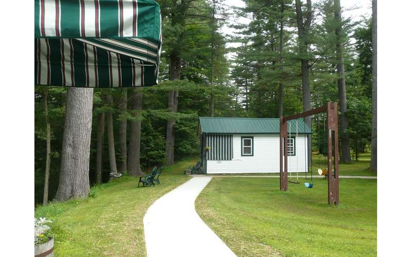 walkway leading to a white cabin