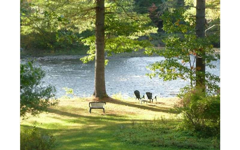 chairs near a river shoreline