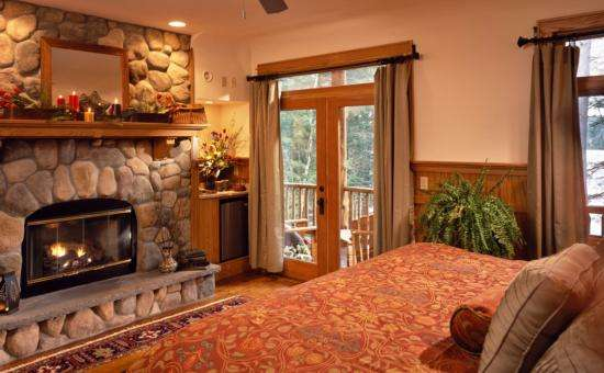 "Our guest room ""Oak"" at $395 features a fireplace, jacuzzi,  refrigerator/wet bar, and lakeview porch to celebrate your special occasion in rustic luxury!"