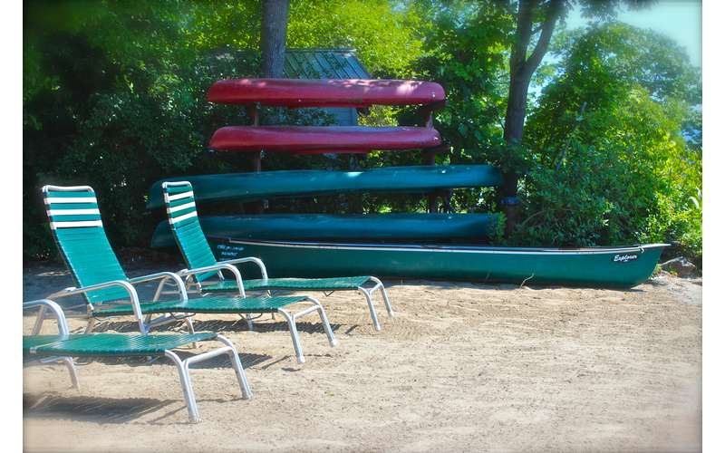 lawn chairs by canoes