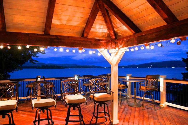 outdoor deck area with chairs and hanging lights