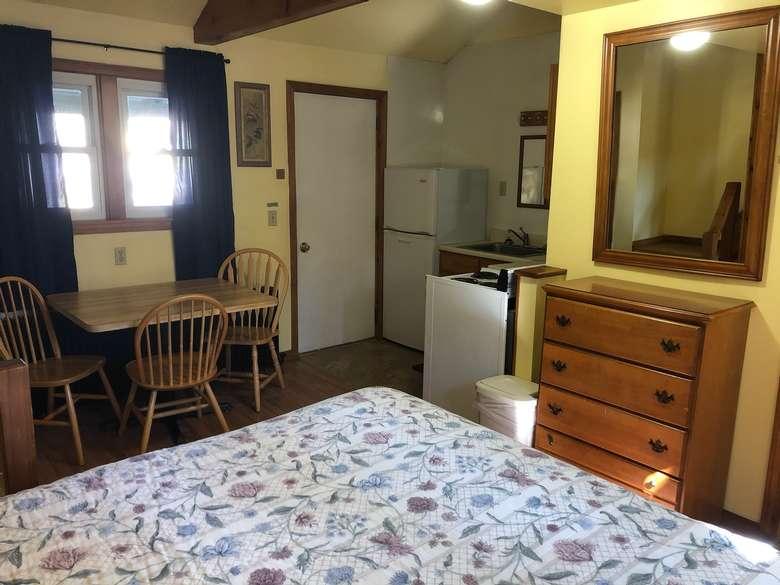 bedroom, kitchen area combined