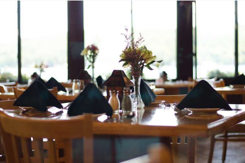 tables and place settings inside the boathouse restaurant