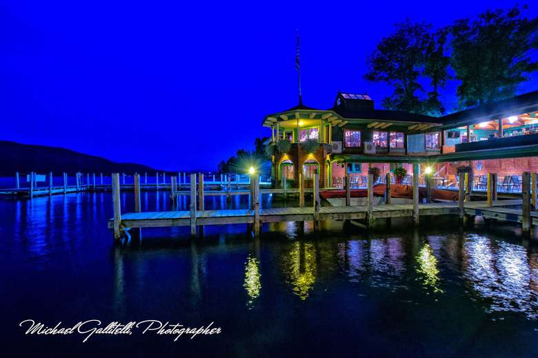 exterior of the boathouse restaurant at night