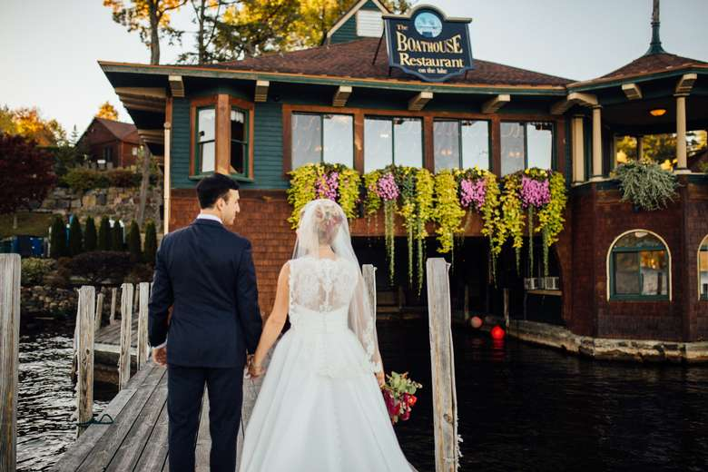 bride and groom in front of the boathouse restaurant