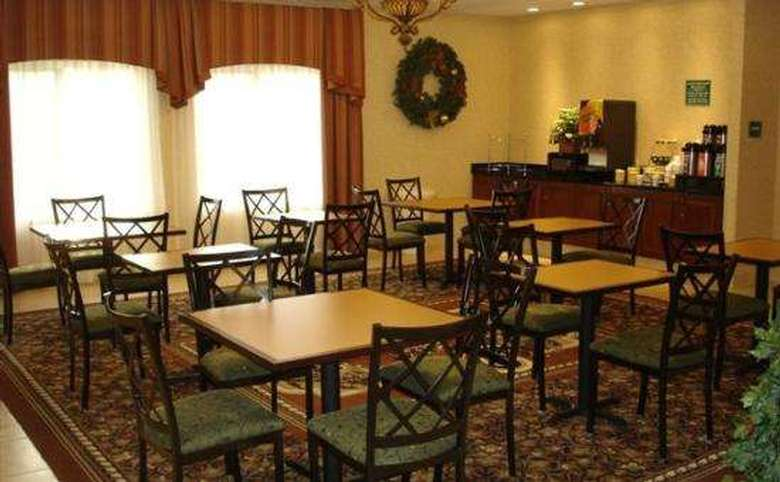 Dining area with many tables and a coffee and drink bar