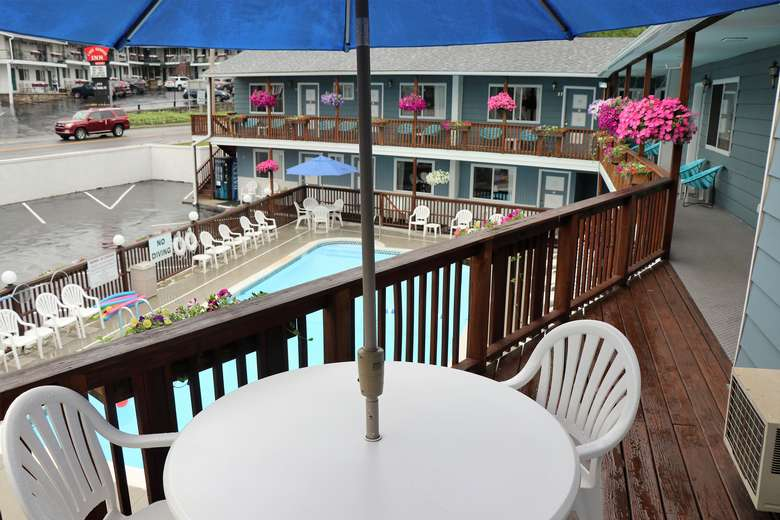 Balcony of a motel room overlooking the pool.