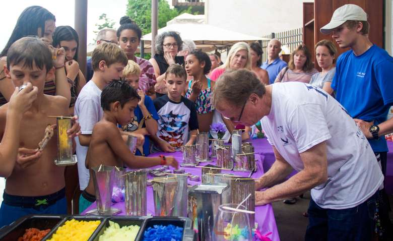 kids participating in a candle-making workshop