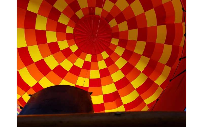 View inside of a red, orange, and yellow hot air balloon