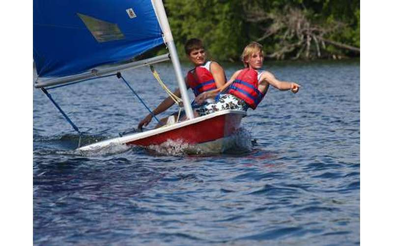 Two boys in a sailboat