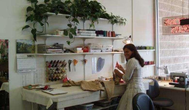 seamstress repairing clothes