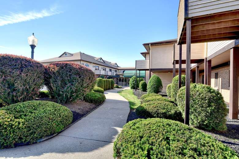 a walkway to a hotel courtyard