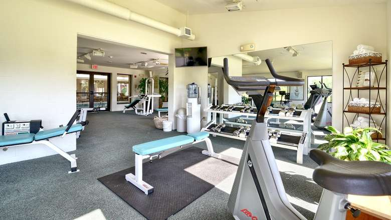 exercise machines and weights in a fitness room