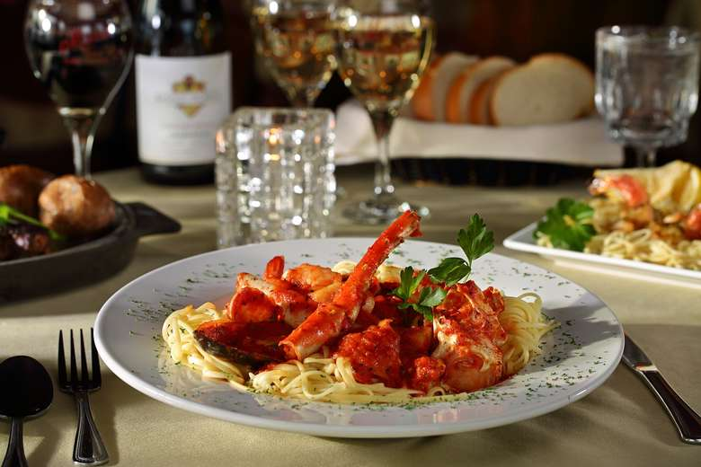 lobster and red sauce over pasta