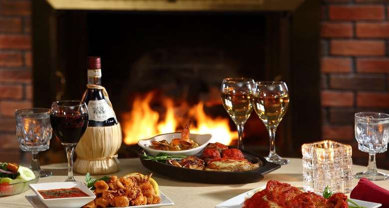 wine and dinner in front of a warm fireplace