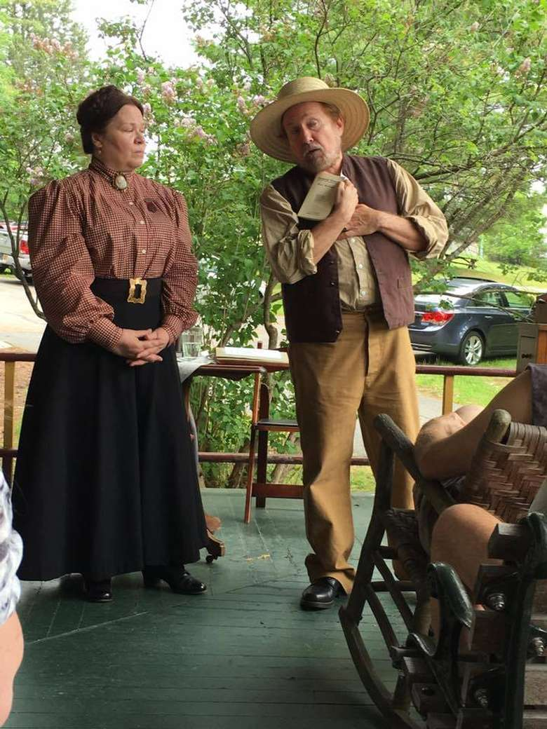costumed reenactors educating a group about president grant and his family