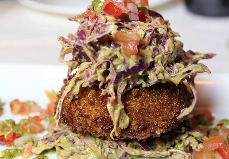 crab cake topped with slaw