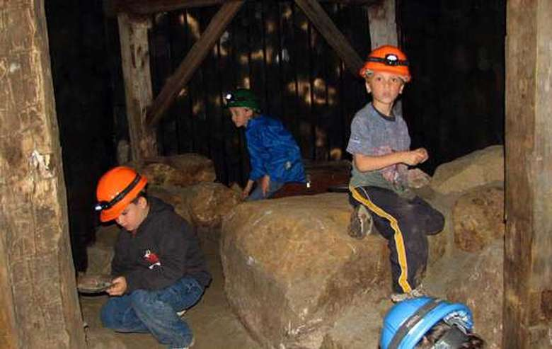 kids in mining helmets looking for crystals