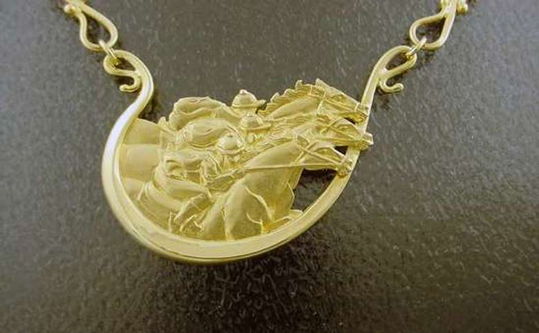 gold necklace featuring jockeys on racehorses