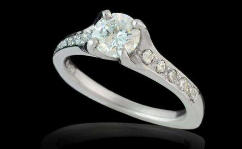 single diamond solitaire engagement ring with small stones set on each side