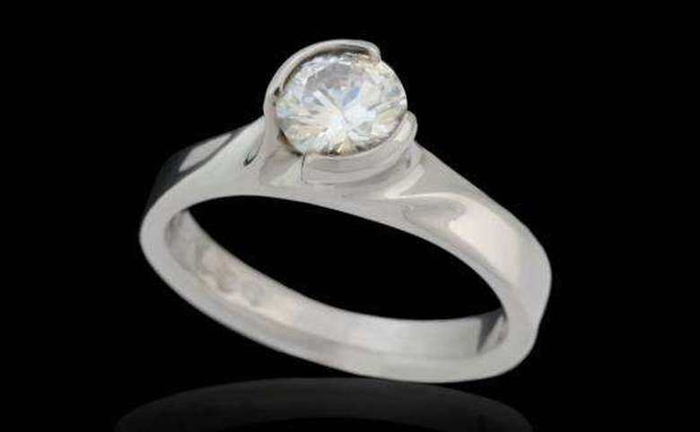 round cut single diamond ring with polished band