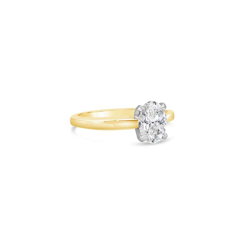 side view of round cut ring with gold band