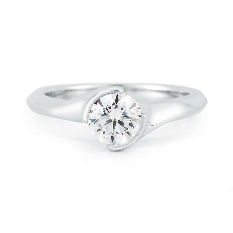 front view of inlaid round cut ring with single large diamond.