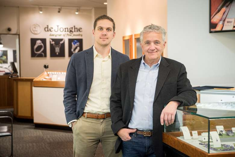 father and son co-owners standing in the deJonghe showroom