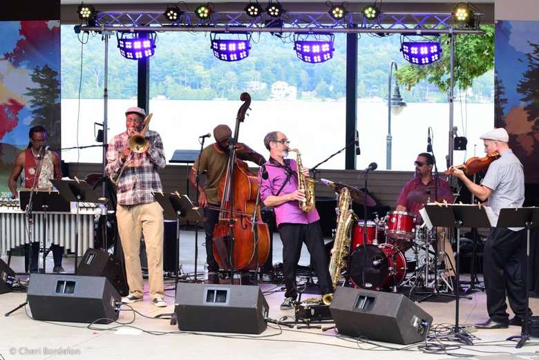 a jazz band performing on an outdoor stage