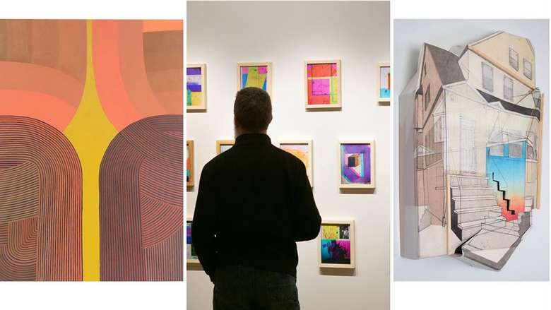 a man looking at three paintings on a wall