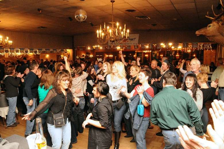 group of people dancing in a room