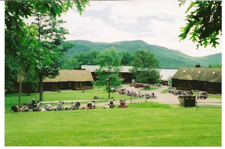 motorcycles near brown buildings