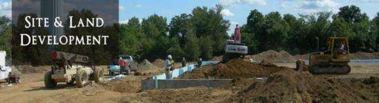 Site & Land Development Words on image of trucks leveling out ground