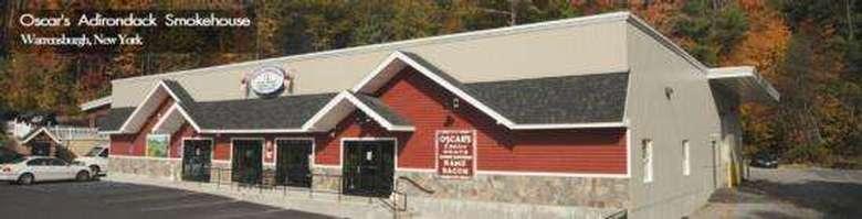 Words Oscar's Adirondack Smokehouse next to image of the smokehouse
