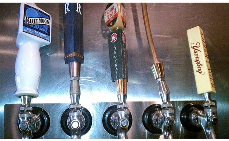 five draft beer tap handles