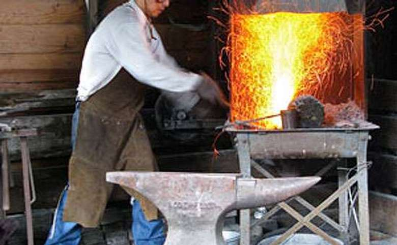 a man working near a forge