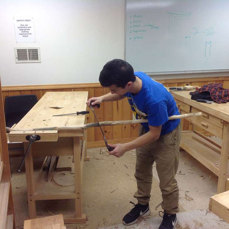 a man working at a wooden table