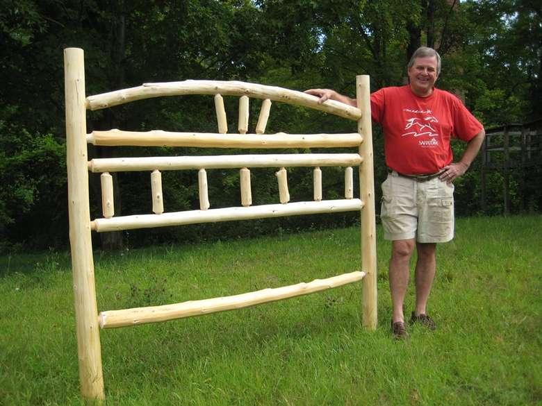 man  standing near a wooden frame
