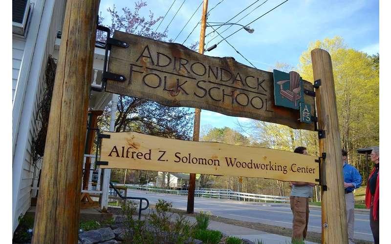 a sign outside the adirondack folk school